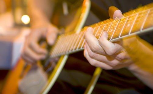 guitar player at Chalet Studio